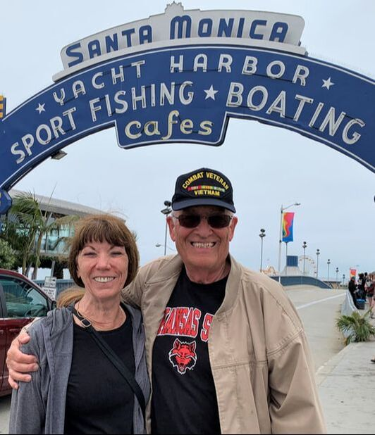 Picture of Herb and Bev Sennett standing in front of the entrance to the Santa Monica, California, Yacht Harbor and Pier.